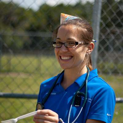 Dr. Amy Stieler, large animal medicine resident, lends a helping hand.