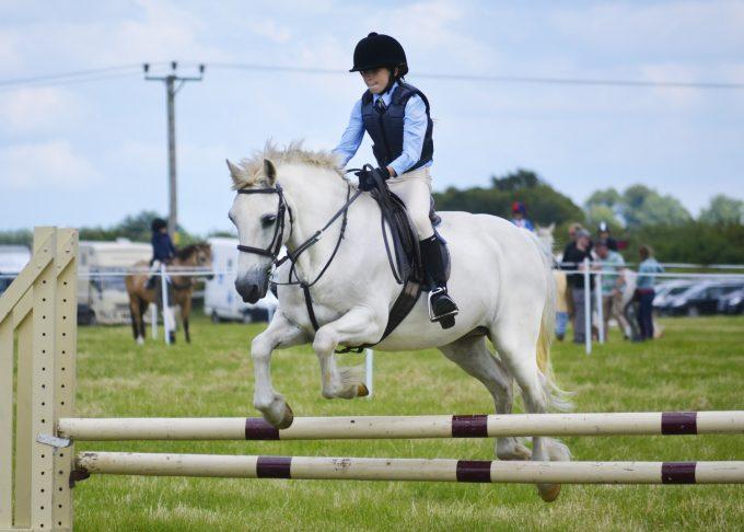 Rider Jumping Horse